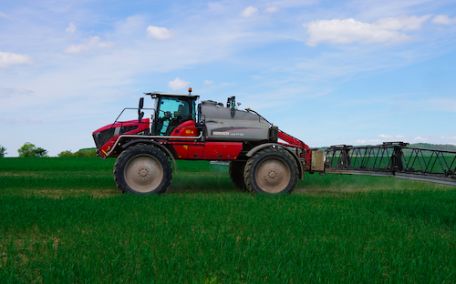 Tractor sprayer on a field